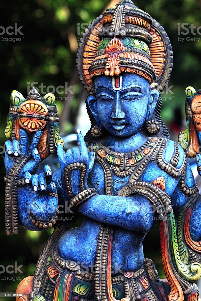 Woodern Statue of Lord Krishna stock photo