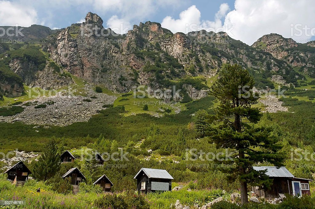 Wood-house (bungalow) by rest-house Maliovitza in Rila mountain, stock photo