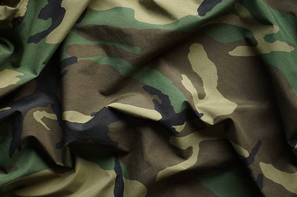 Woodland Camouflage Woodland material on camouflage camouflage stock pictures, royalty-free photos & images