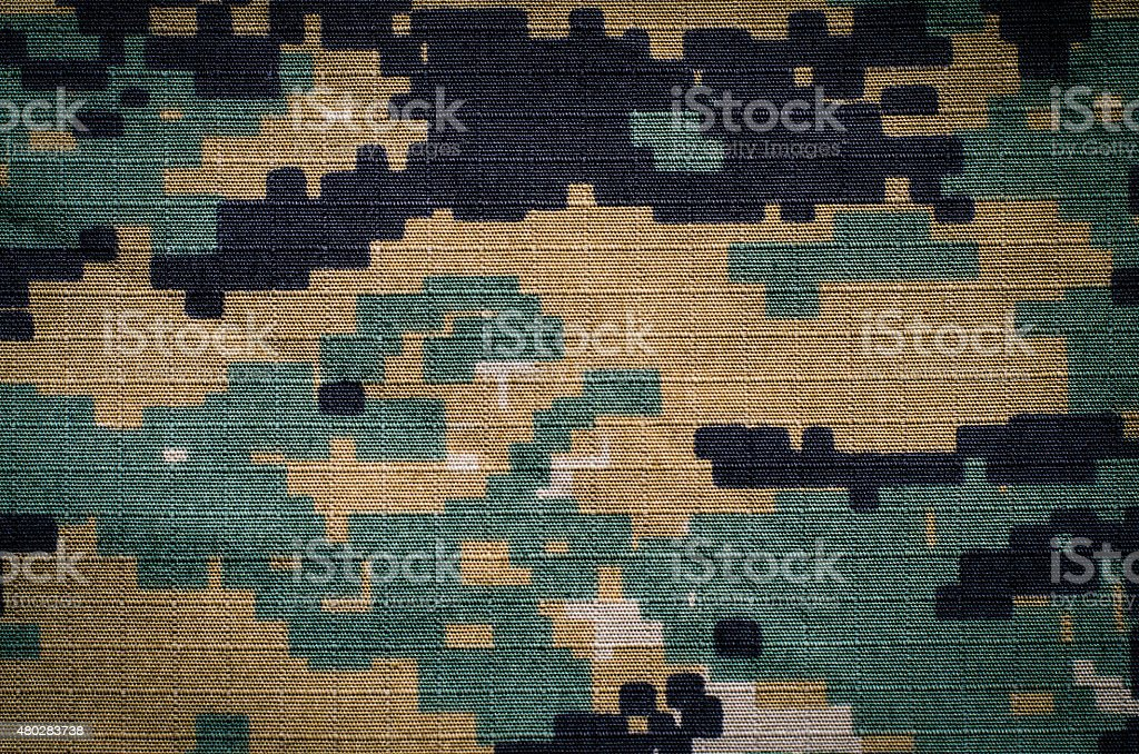 Woodland digital camouflage rip-stop fabric texture background stock photo