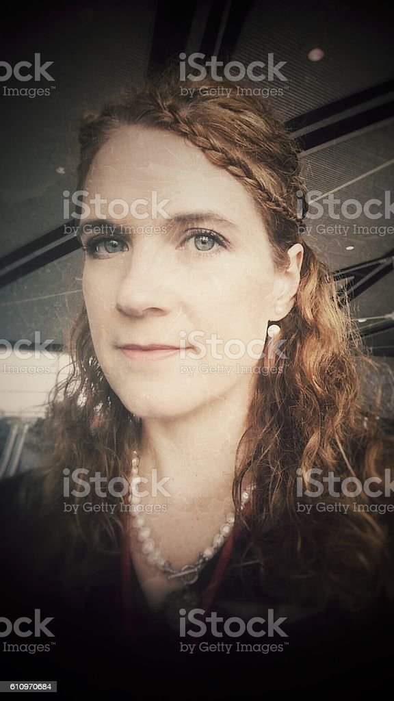 Woodland Elf Braided Curly Hair Angular Chin Female Wearing Pearls