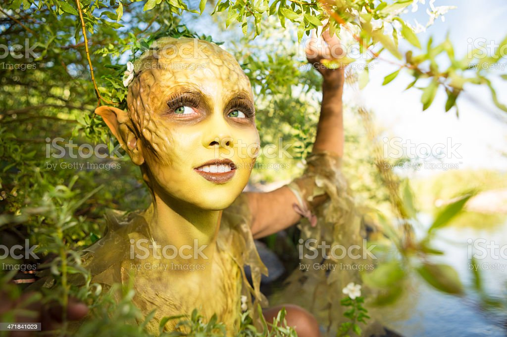 Woodland fairy creature character actor in stage makeup royalty-free stock photo