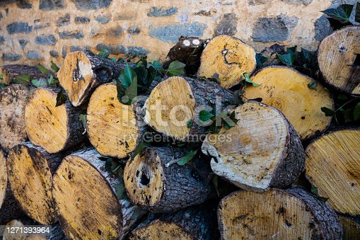 Wood piles near the wall in a village