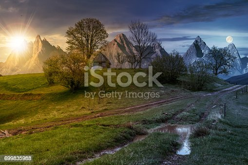 1074120624 istock photo woodshed among trees on a hill by the road in High Tatras 699835988