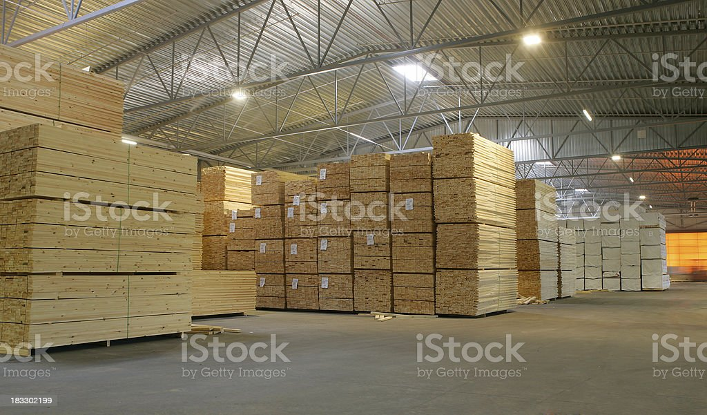 Woodsupply in a warehouse stock photo