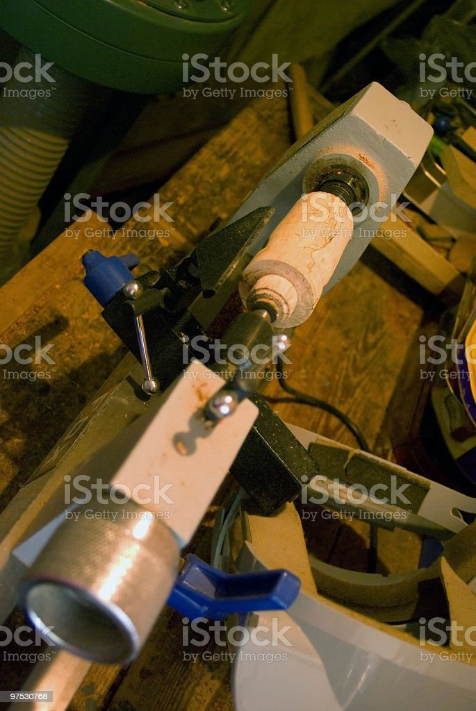 Woodturning Lathe closeup with spalted wood on the chuck royalty-free stock photo