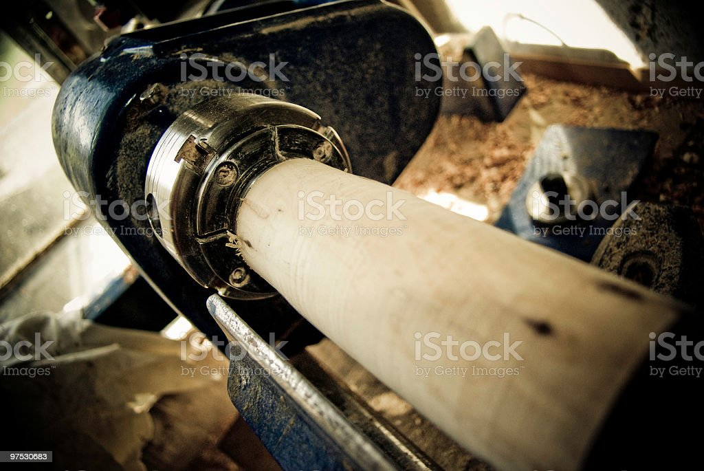 Woodturning Lathe closeup with wood on the chuck royalty-free stock photo