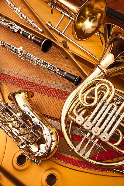 woodwind and brass instruments - musical instrument stock photos and pictures