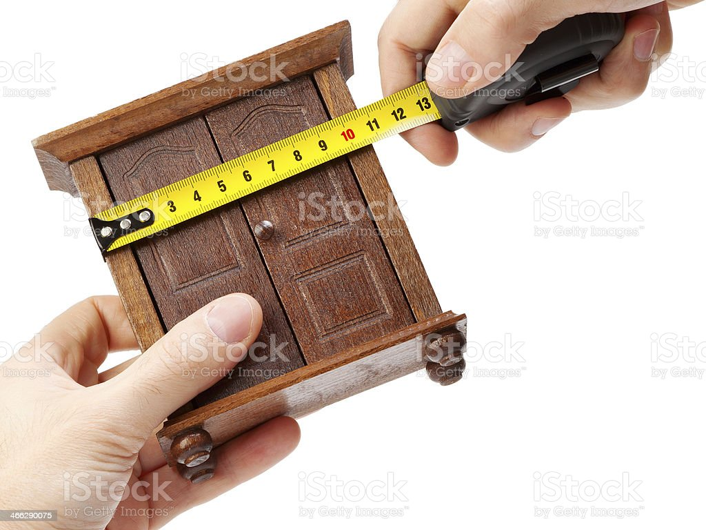 woodworker measuring wardrobe with a tape measure stock photo