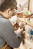 Woodworker working on grinder