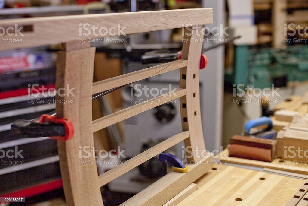 Woodworking - Chair back clamped on workbench stock photo
