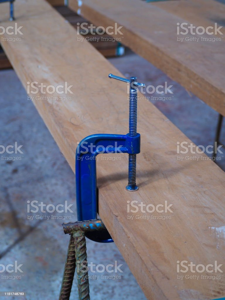 Woodworking Clamp Holding Workpiece Stock Photo Download Image Now Istock