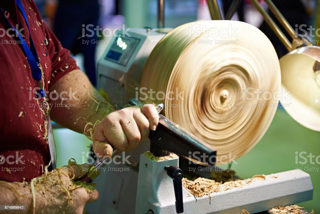 Woodworking on a lathe stock photo