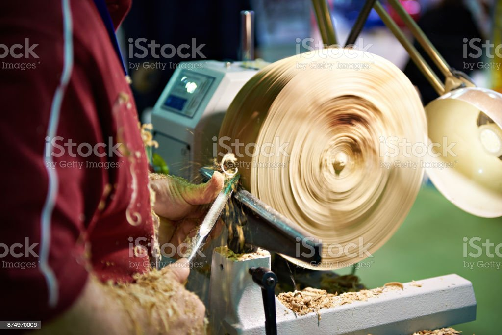 Woodworking on lathe stock photo