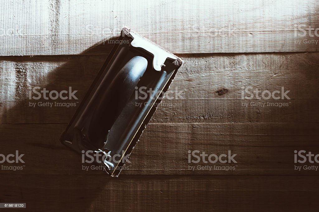 Woodworking tools, hand sander, sandpaper on workbench. stock photo