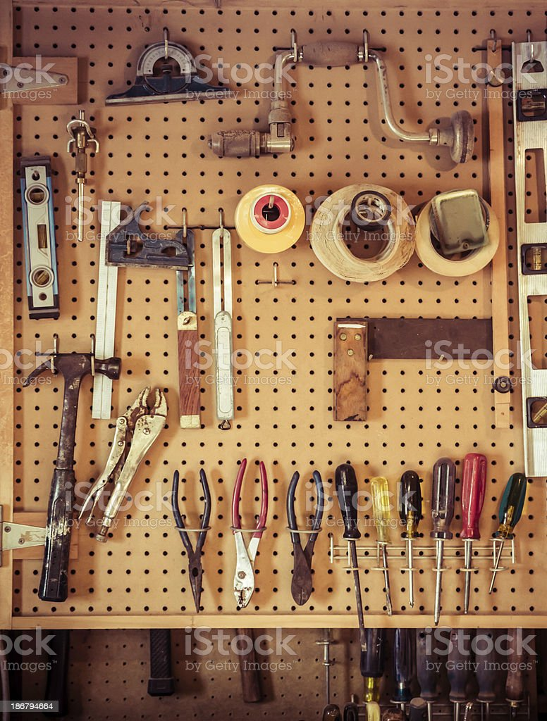 Woodworking Tools Hang On Old Pehgboard In A Woodshop ...