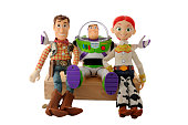 """""""Athens, Greece - September 11, 2012: Toy replicas of Woody, Buzz Lightyear, and Jessie. Main characters of Toy Story films produced by Pixar Animation Studios and released by Walt Disney Pictures. Product shot isolated on white."""""""