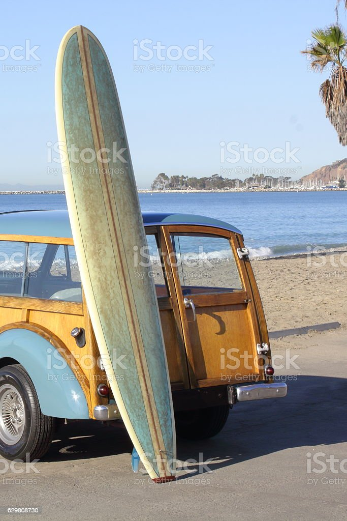 Woody, Waves and Surfboard stock photo