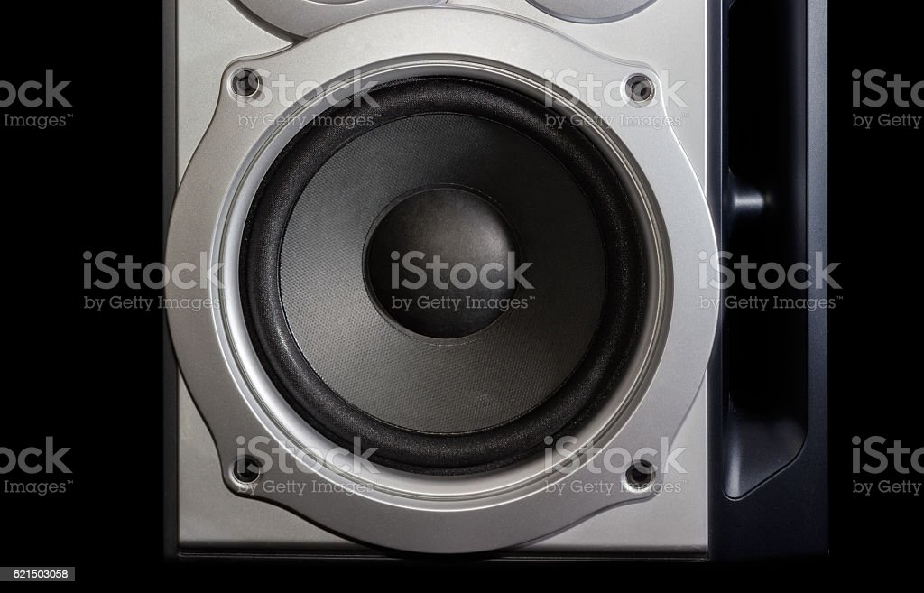 Woofer of a home loudspeaker closeup on the dark background Lizenzfreies stock-foto
