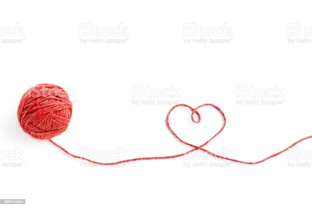 Wool ball and thread in shape of heart isolated on white background stock photo