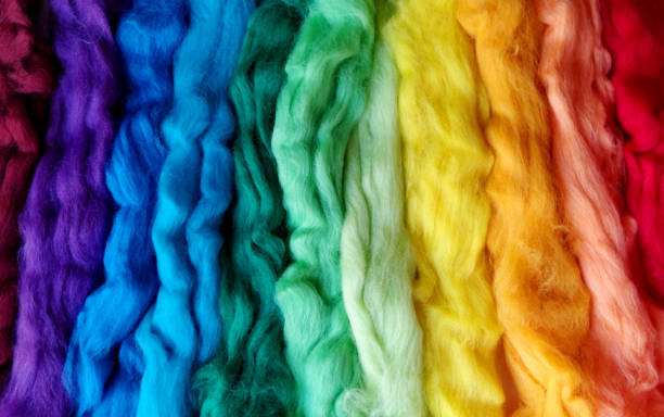 wool for felting different colors of the rainbow. wool for felting different colors of the rainbow. striped woolen background. textural abstract colorful background merino sheep stock pictures, royalty-free photos & images