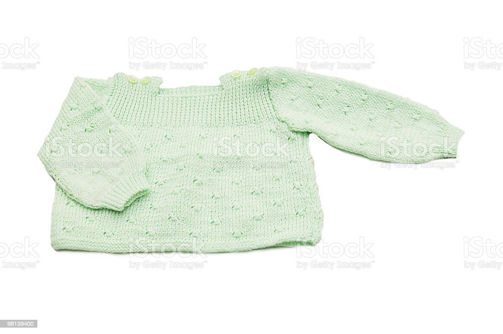 Wool hand-made green baby coat royalty-free stock photo