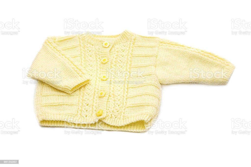 Wool hand-made yellow baby coat royalty-free stock photo