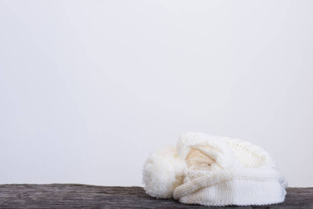 wool hat is placed on a wooden floor. stock photo