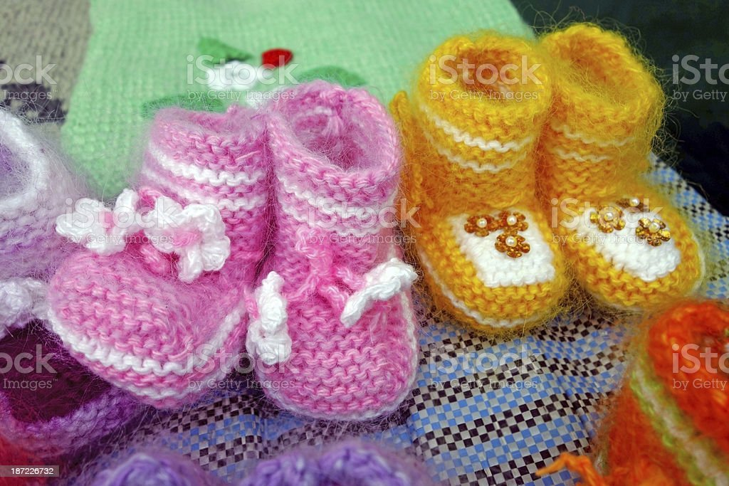 Wool knitted baby shoes royalty-free stock photo