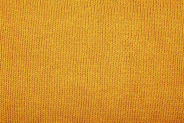 wool sweater texture close up. knitted jersey background with a - hausgemachte teppichreiniger stock-fotos und bilder