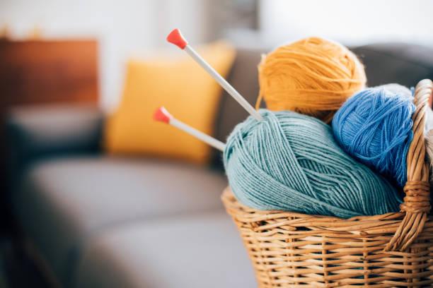 wool yarn in coils - a maglia foto e immagini stock