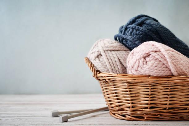 wool yarn in coils - lavorare a maglia foto e immagini stock