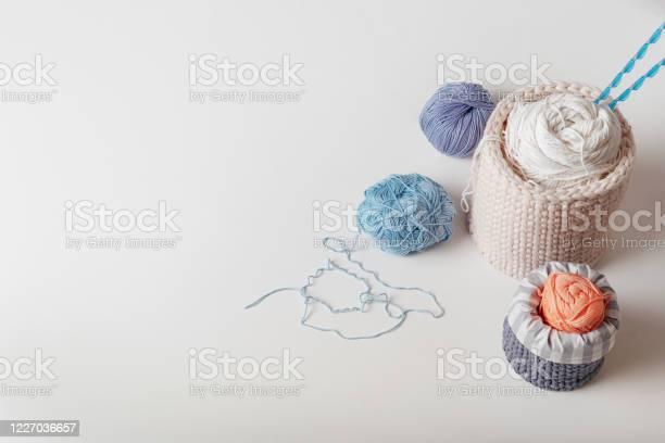 Wool yarn in coils with knitting needles in wicker basket on white picture id1227036657?b=1&k=6&m=1227036657&s=612x612&h=gn1zf69jnibidaf1dslex7dp1jotq0q30eg4tso4ko0=
