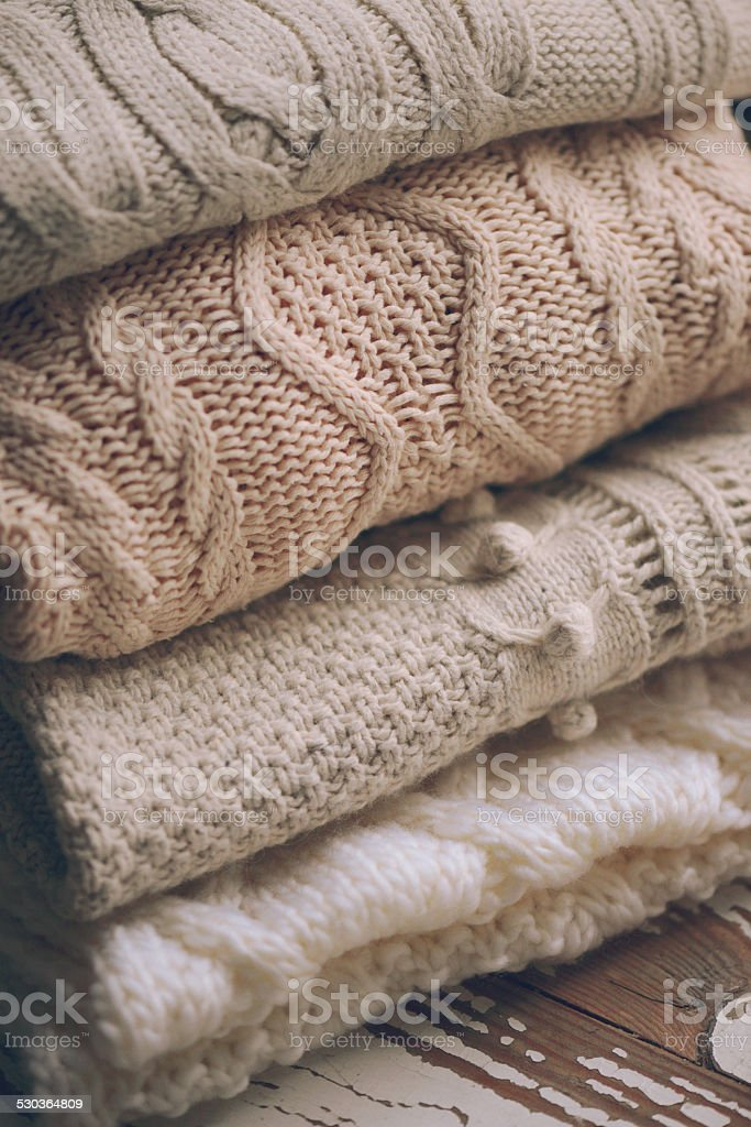 woolen clothing on a wooden background stock photo