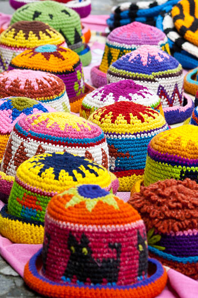 Woolen hats in the market of Otavalo stock photo