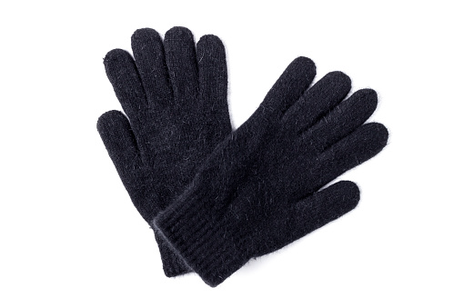 Black winter wool knitted gloves isolated on white background