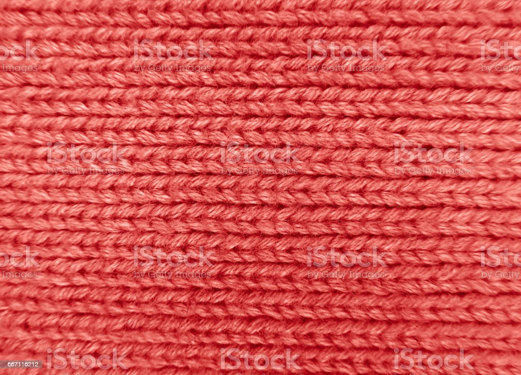 Woolen knitted texture - red stock photo