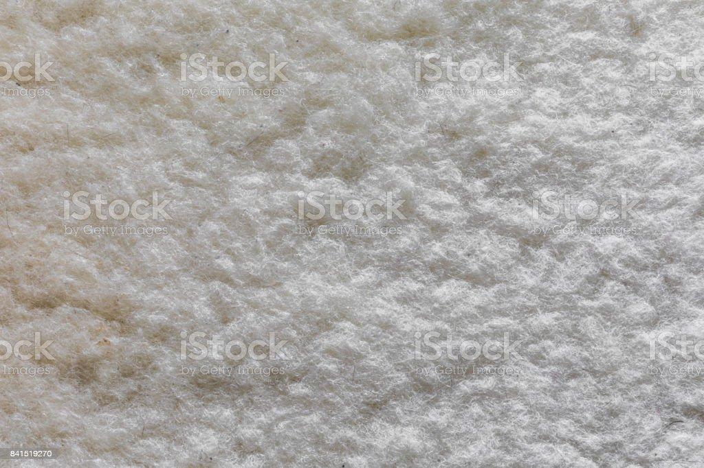 Woolen mat white texture with natural patterns can be used as background stock photo