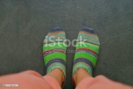 legs in woolen socks