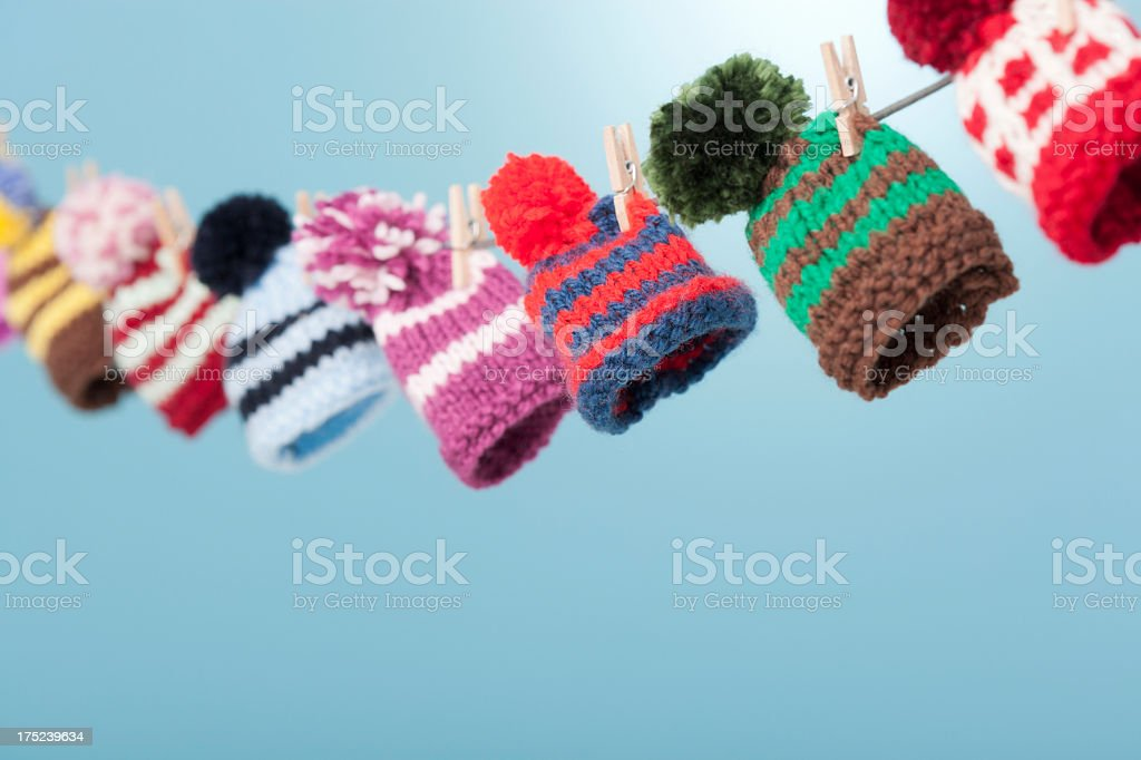 Wooly hats hanging from clothes line royalty-free stock photo