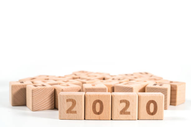 word 2020 on wood cube dices on white background. stock photo