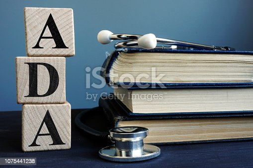 Word ADA Americans with Disabilities Act from cubes and books.