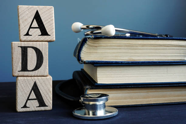 Word ADA Americans with Disabilities Act from cubes and books. stock photo