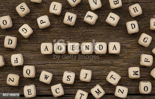 istock Word AGENDA made with wood building blocks 853188826