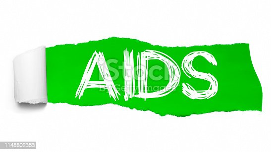 istock Word AIDS appearing behind green torn paper 1148802353