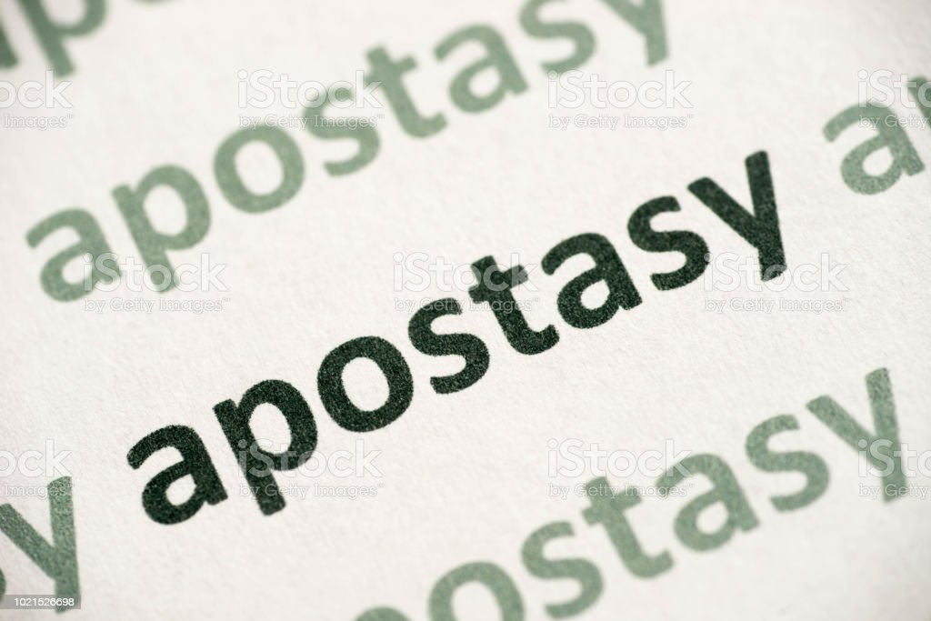 word apostasy  printed on paper macro word apostasy printed on white paper macro Abstract Stock Photo
