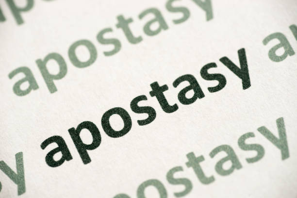 word apostasy  printed on paper macro word apostasy printed on white paper macro apostate stock pictures, royalty-free photos & images
