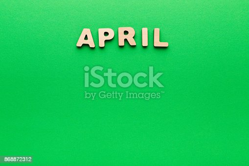 istock Word April on green background 868872312