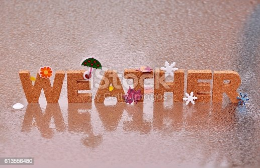 istock WEATHER word arranged of cork letters and stickers. 613556480