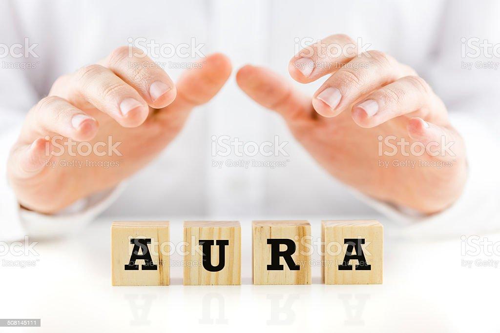 Word - Aura on wooden cubes stock photo